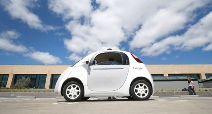 Google teams up with Ford to build self-driving cars