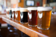 stock-photo-41310818-row-of-different-beers-in-glasses-on-a-wooden-bar